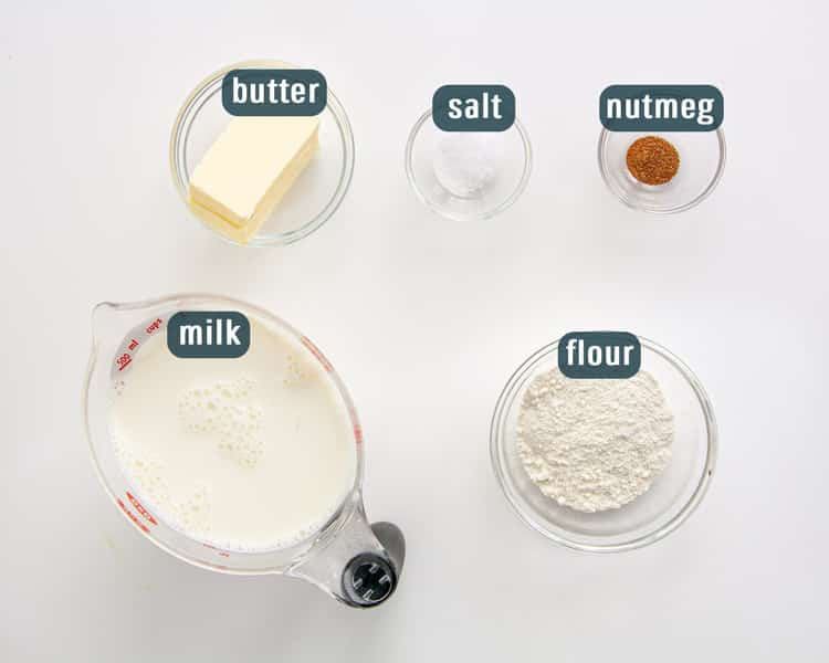 overhead shot of all the ingredients needed to make bechamel sauce