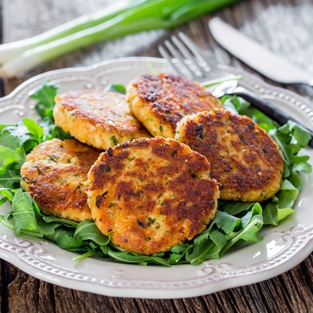 Easy Crab Cakes on a bed of arugula on a white plate