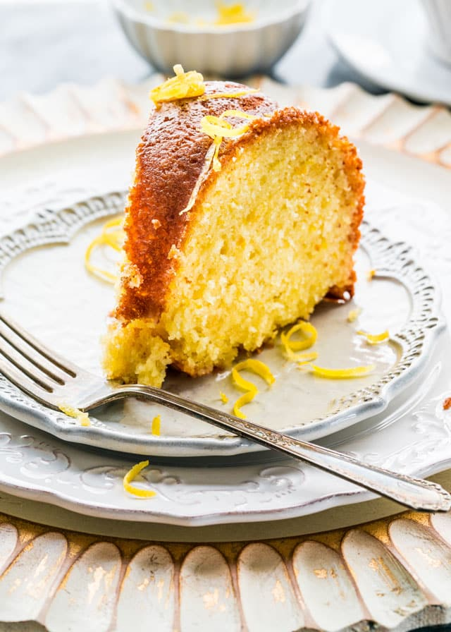a slice of lemon bundt cake on a plate with a fork