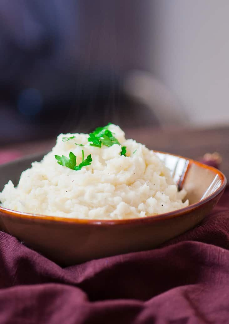 These Easy Skinny Mashed Potatoes are made from scratch, super delicious and only 146 calories a serving.