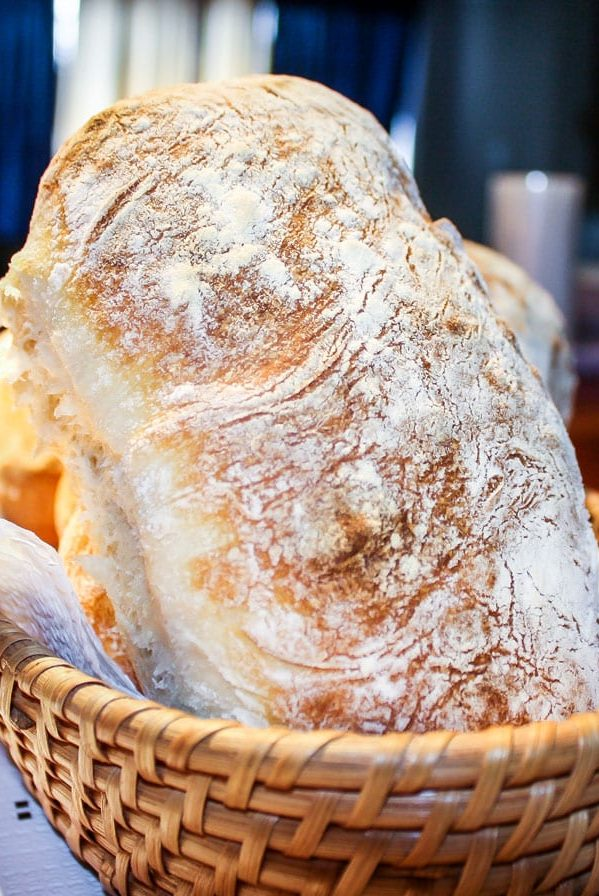a loaf of ciabatta bread in a wicker basket