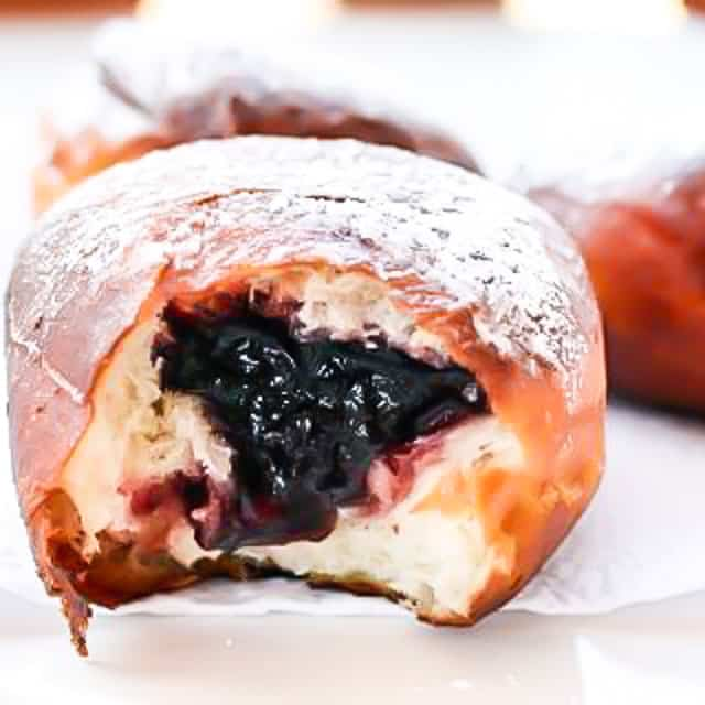 Paczki are a delicious traditional Polish donut, popular on Fat Tuesday or before Easter before Lent. My version here of these delectable morsels is filled with Saskatoon berry jam and sprinkled with powdered sugar.