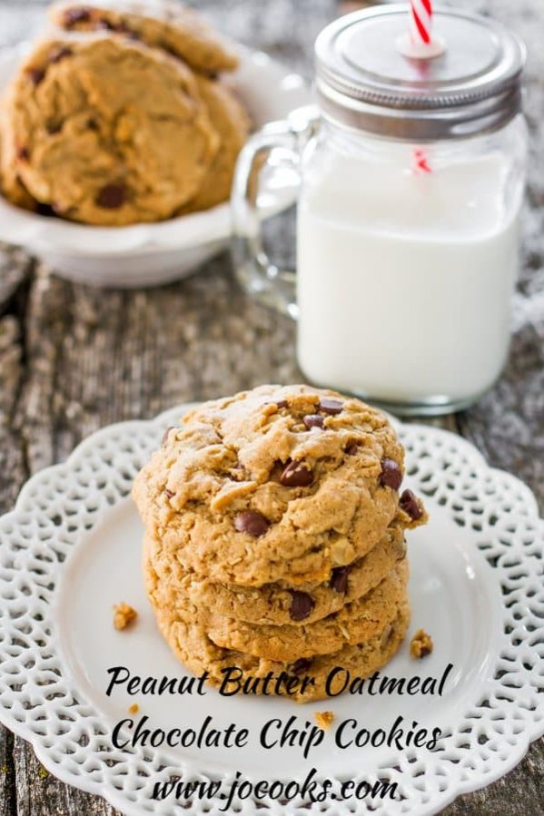 a stack of cookies on a plate with a glass of milk