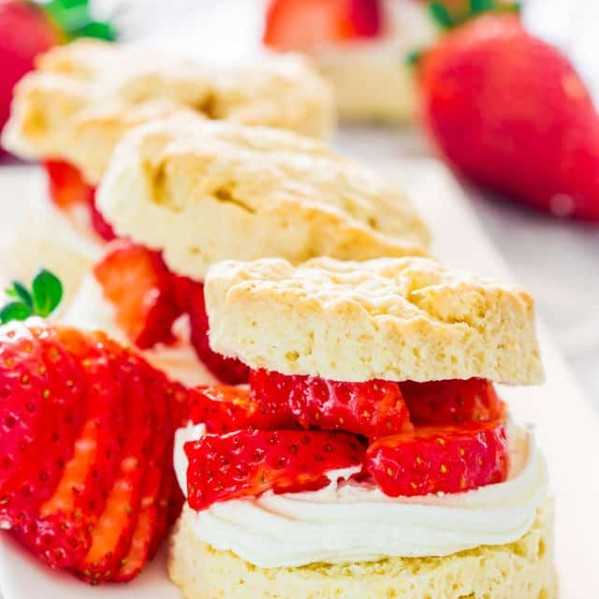 strawberry shortcakes lined up on a plate