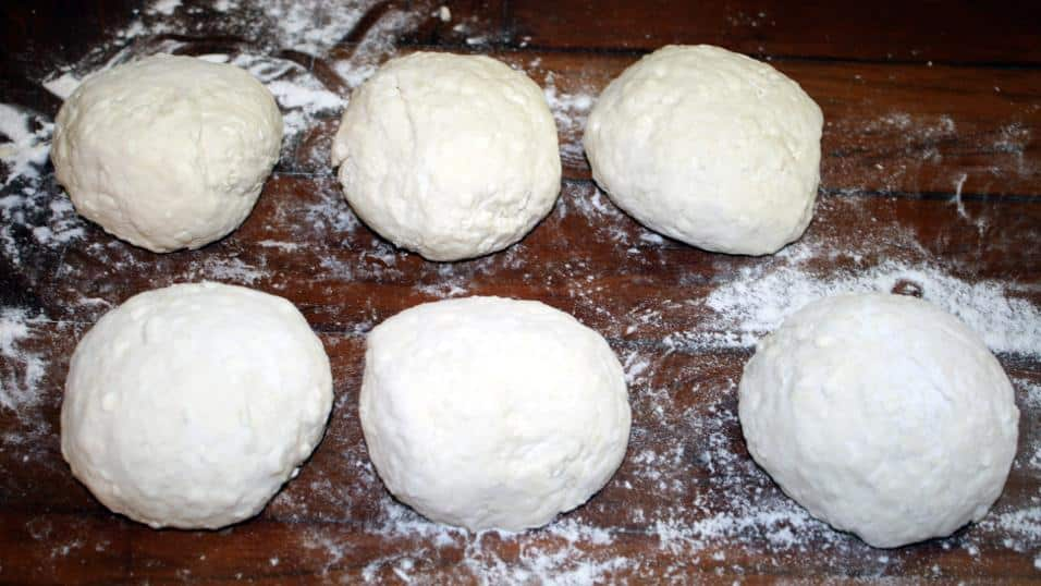 6 Balls of Feta dough lined up.