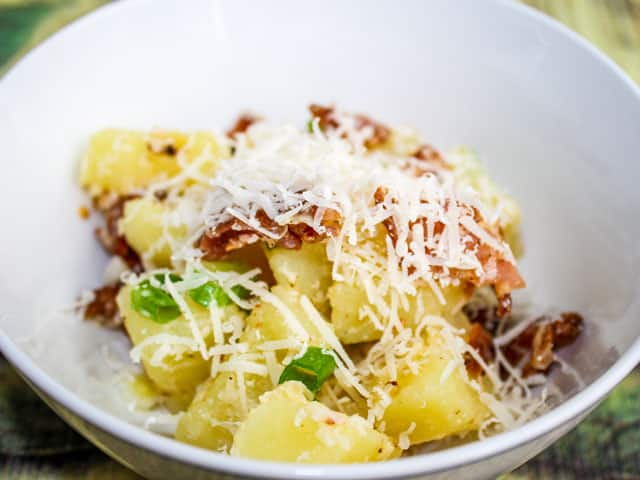 side shot of Italian Potato Salad with grated Parmesan cheese