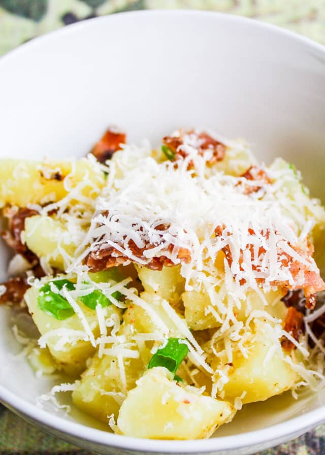 Italian Potato Salad with grated Parmesan cheese in a bowl