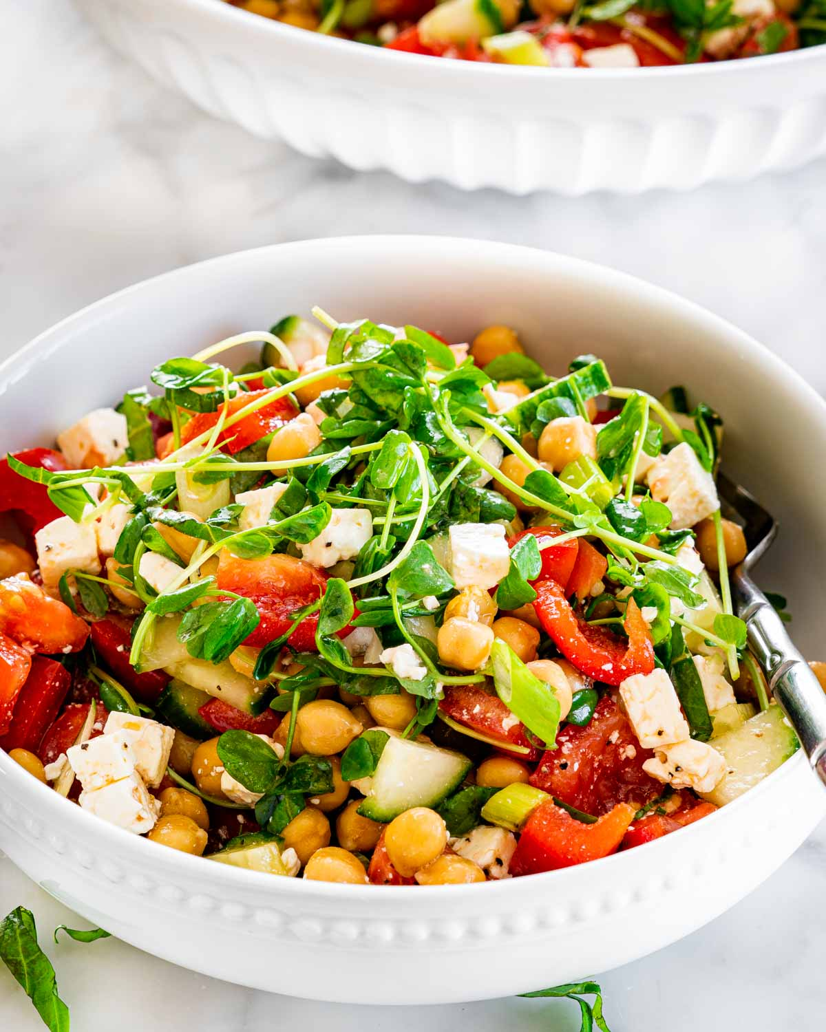 chickpea salad in a small white bowl