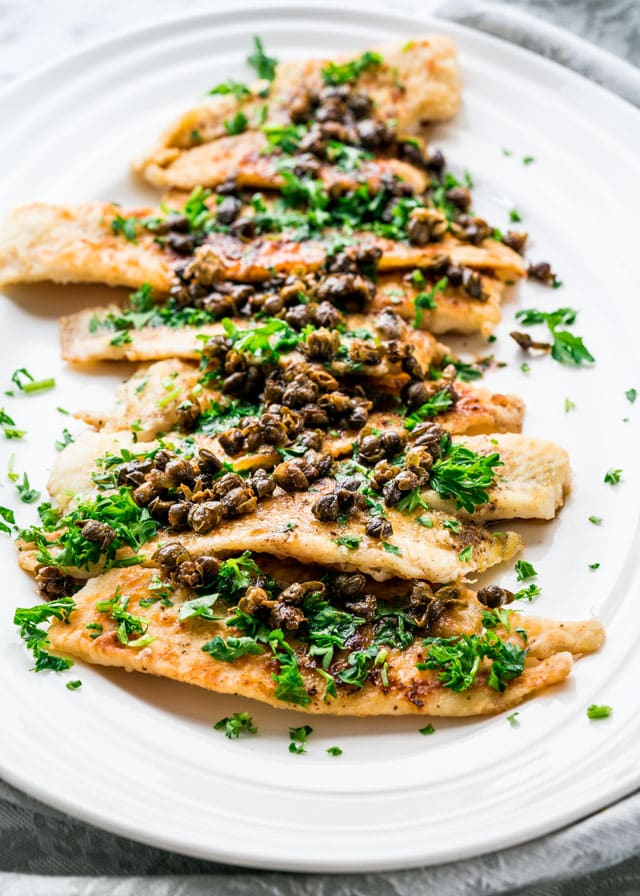 Sole Meuniere topped with capers on a platter