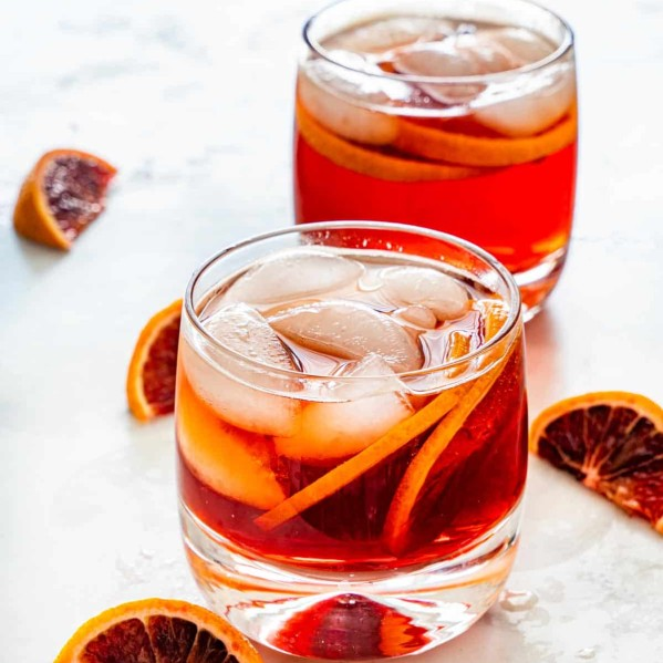 two americano cocktails in short classes, garnished with blood oranges