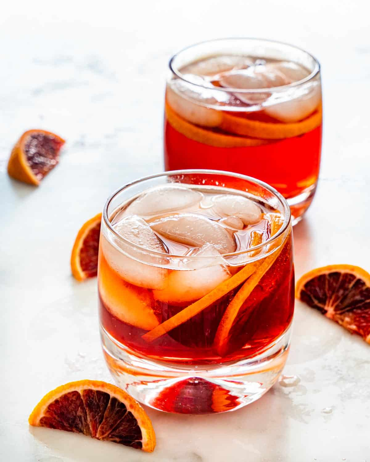 americano cocktail garnished with blood orange in two glasses