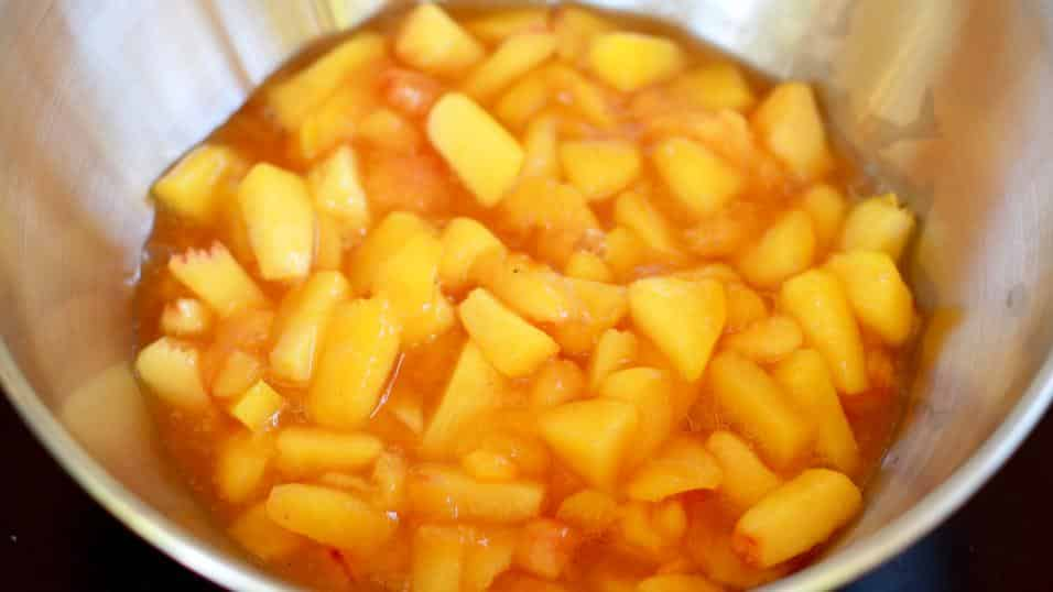 A bowl of chopped peaches