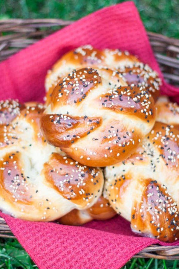 a basket full of portuguese sweet bread rolls