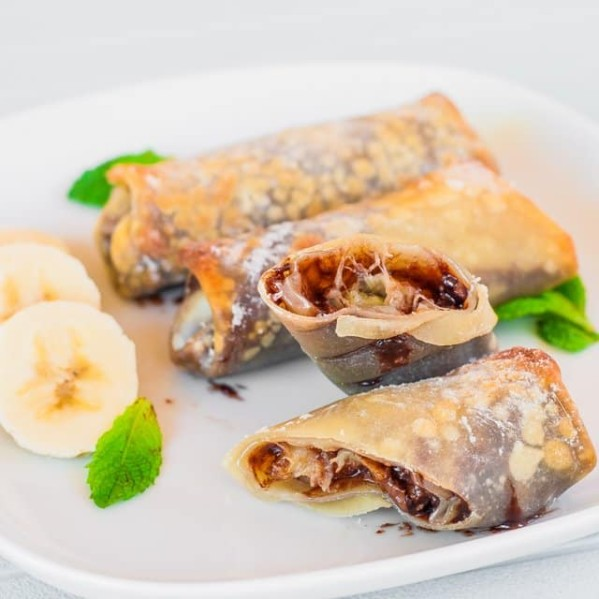 a plate of banana nutella rolls with one split in half
