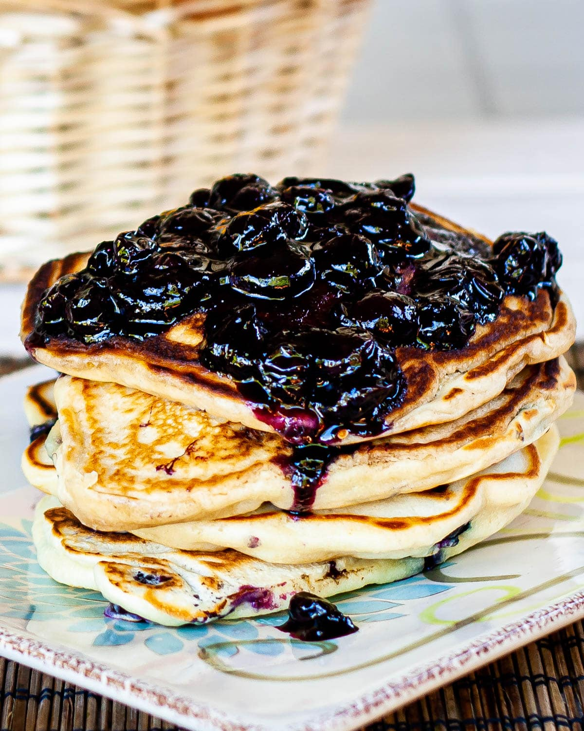 blueberry buttermilk pancakes with lots of blueberry sauce over them