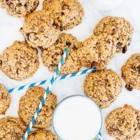 overhead shot of oatmeal cookies surrounding a glass of milk