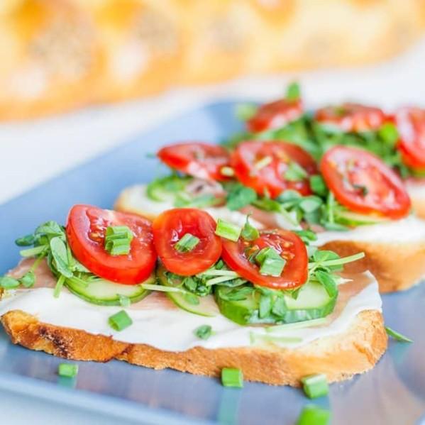 three prosciutto and veggie sandwiches