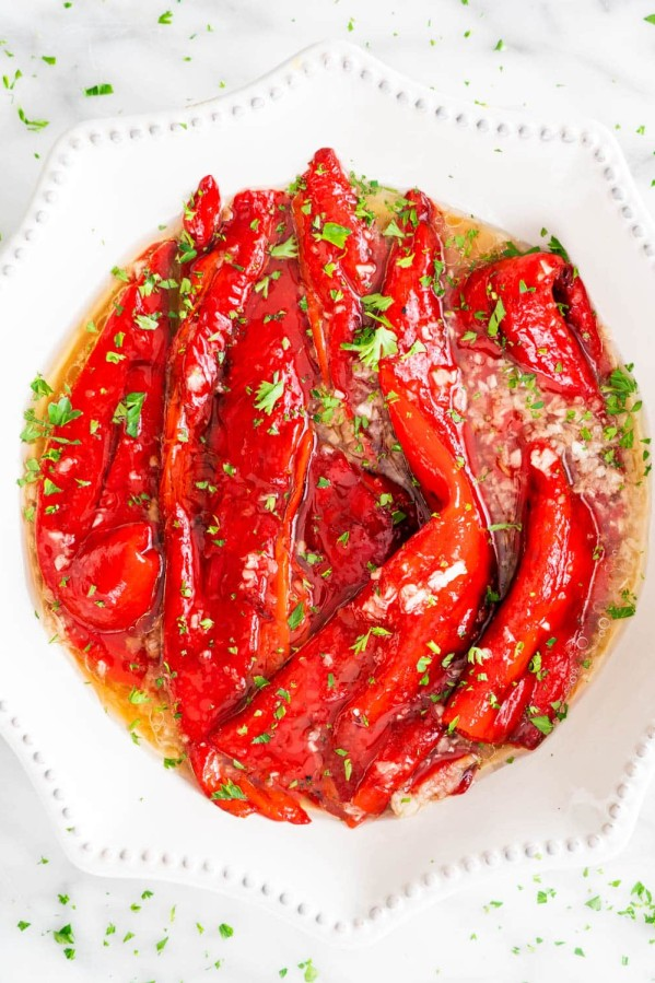 overhead shot of a bowl full of roasted red peppers