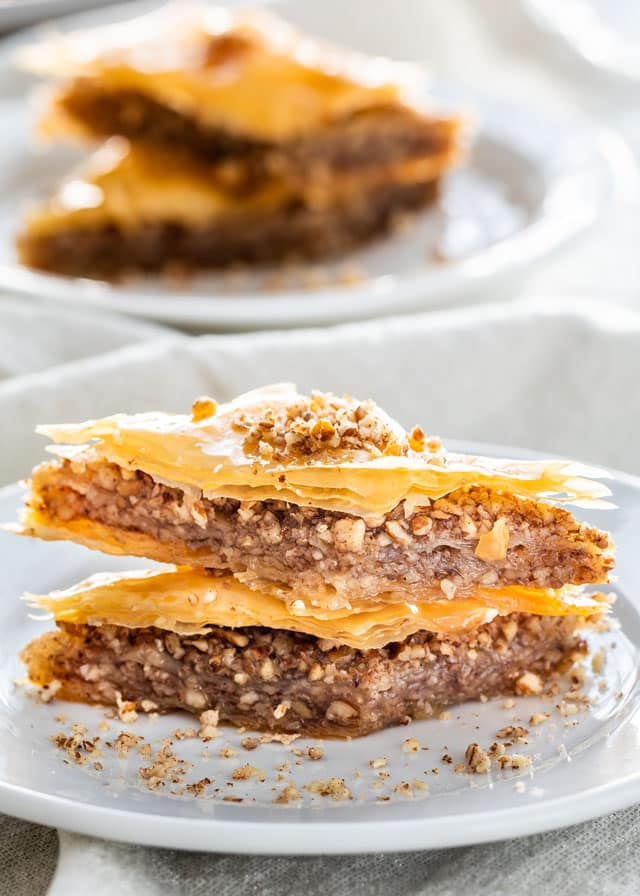 two slices of baklava on a white plate