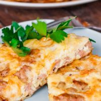 two slices of mushroom and sausage frittata on a plate