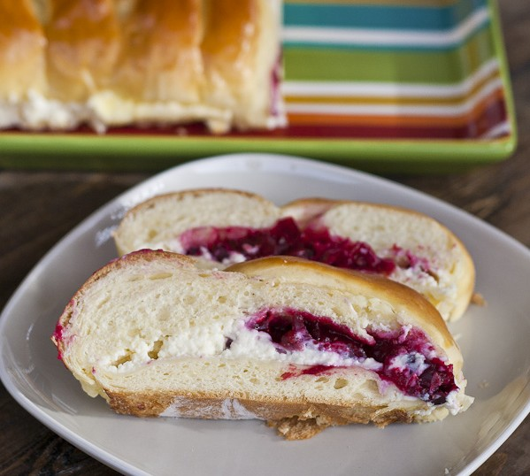 slices of cranberry and cream cheese bread on a plate