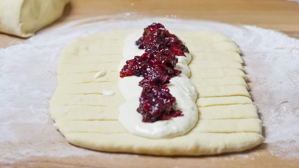 Process shot of assembling Cranberries and Cream Cheese Bread