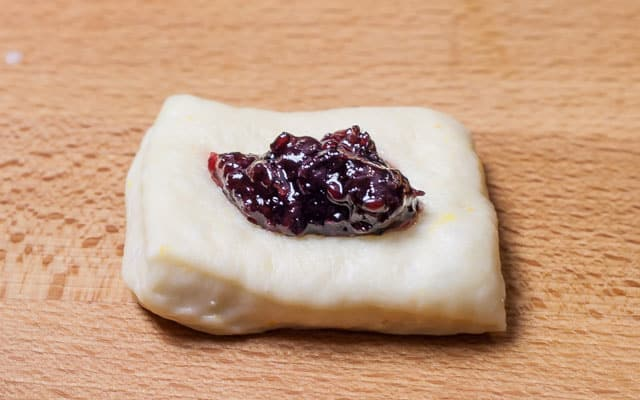 Dough with jam filling on top