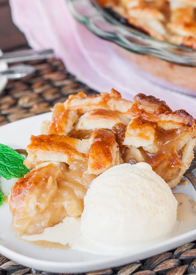A piece of Caramel Pear Pie with a scoop of vanilla ice cream