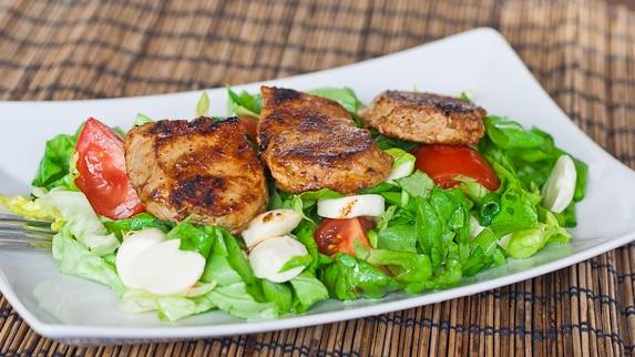 Bourbon Dijon Tenderloin atop a salad