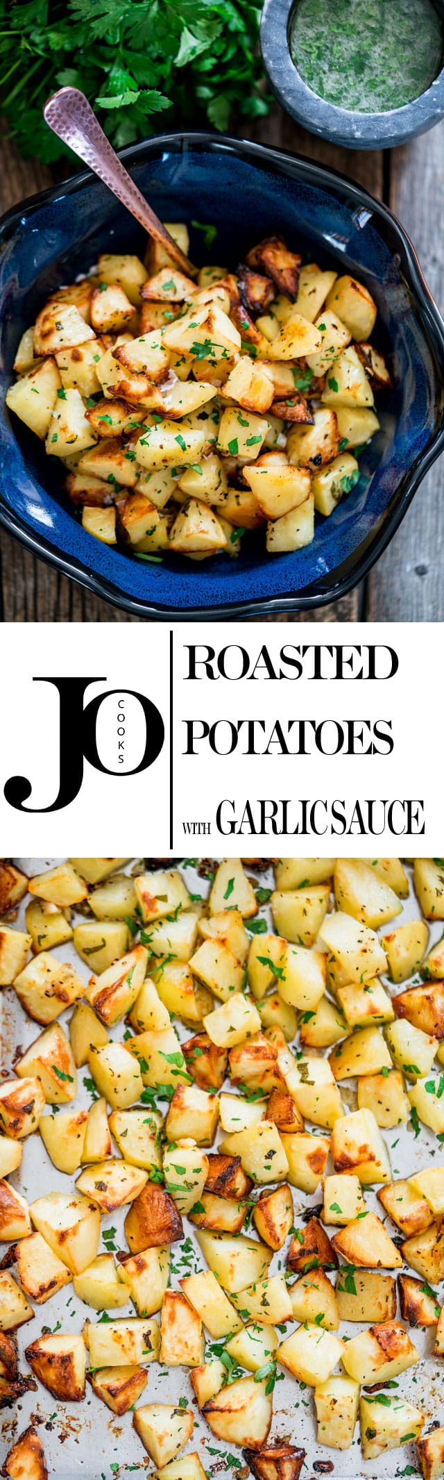 Roasted Potatoes With Garlic Sauce – the best roasted potatoes you will ever eat. These potatoes are tossed generously in fresh garlic and parsley, then roasted to golden brown perfection. www.jocooks.com #garlicpotatoes