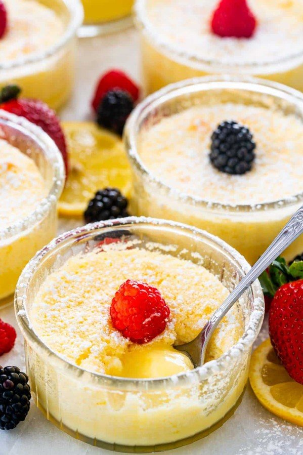 ramekins of lemon pudding cakes garnished with berries.