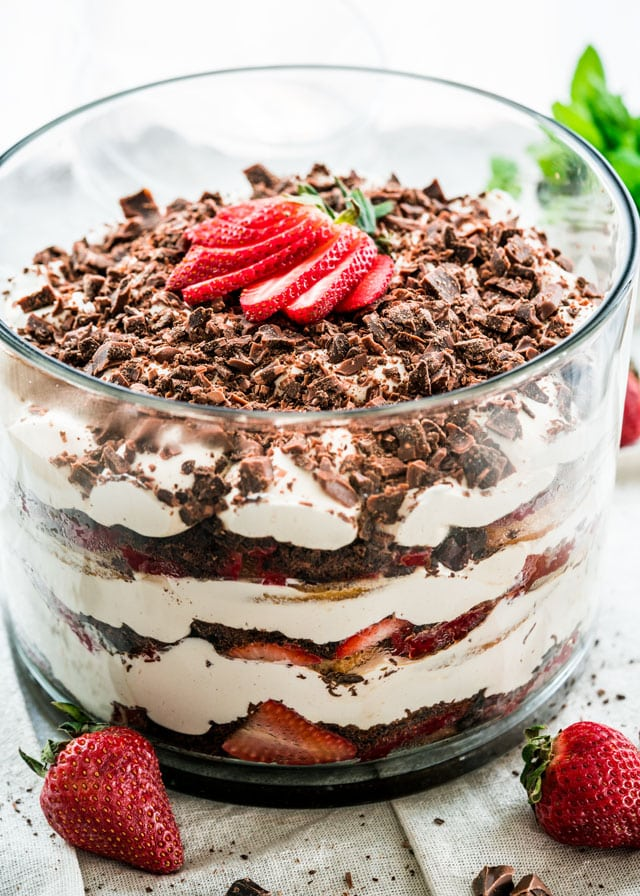 This Strawberry Tiramisu Trifle is a classic dessert that gets a berry twist with lots of strawberries, chocolate and a fabulous mascarpone and pudding cream, still with lots of coffee flavor!