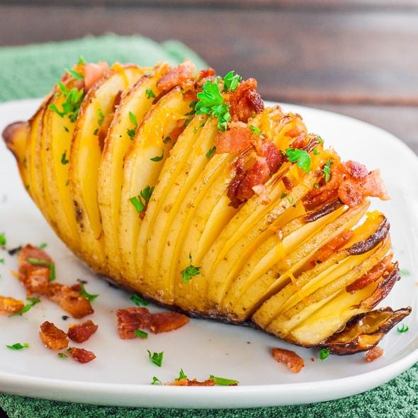 a hasselback potato on a plate