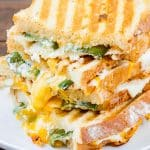 side view shot of 4 jalapeno popper grilled cheese stacked on top of each other