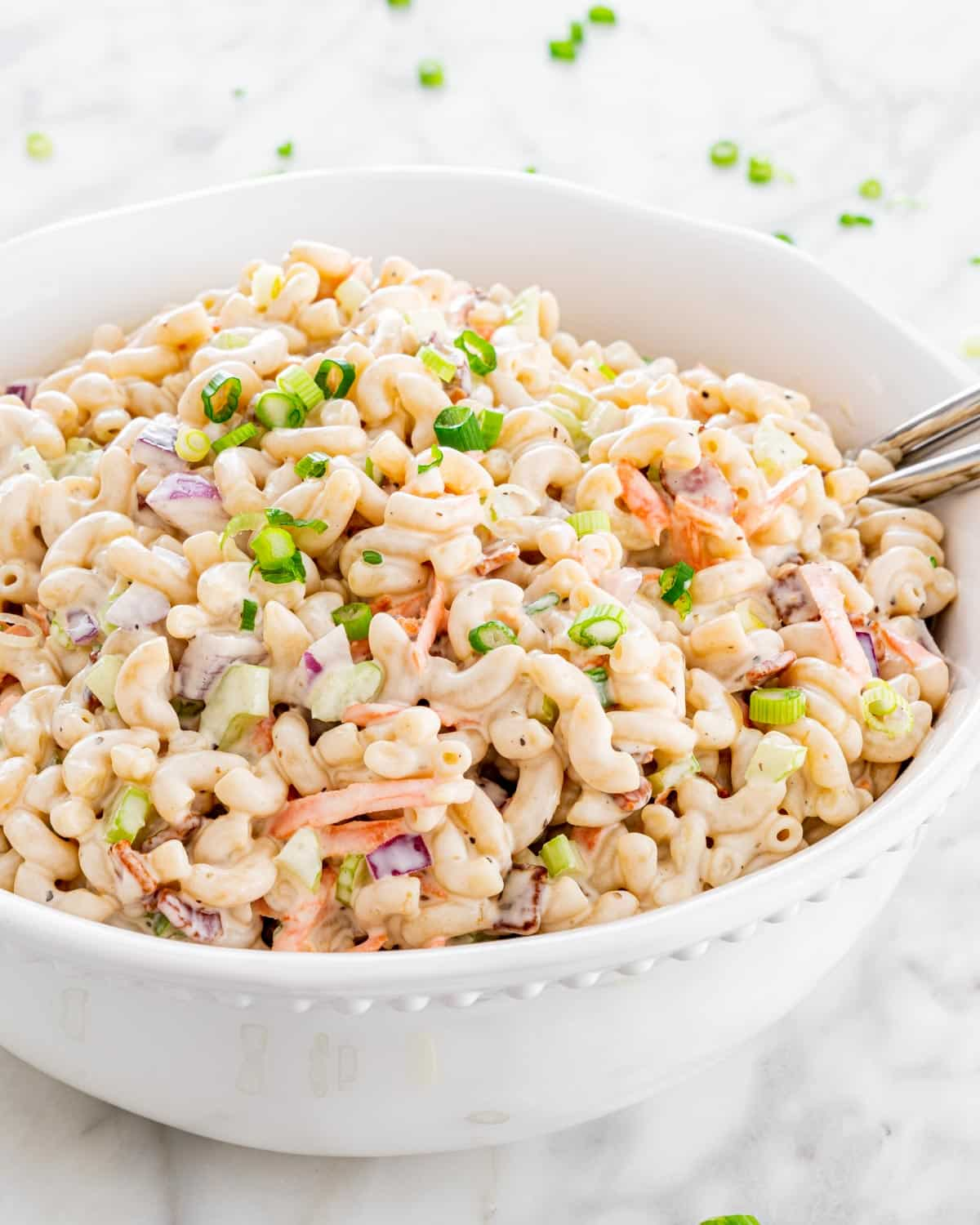 a big bowl loaded with a classic macaroni salad