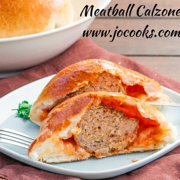 meatball calzone cut in half exposing the center