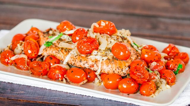 Salmon with Roasted Tomatoes and Onions on a plate