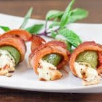 screaming stuffed jalapeno poppers wrapped in bacon
