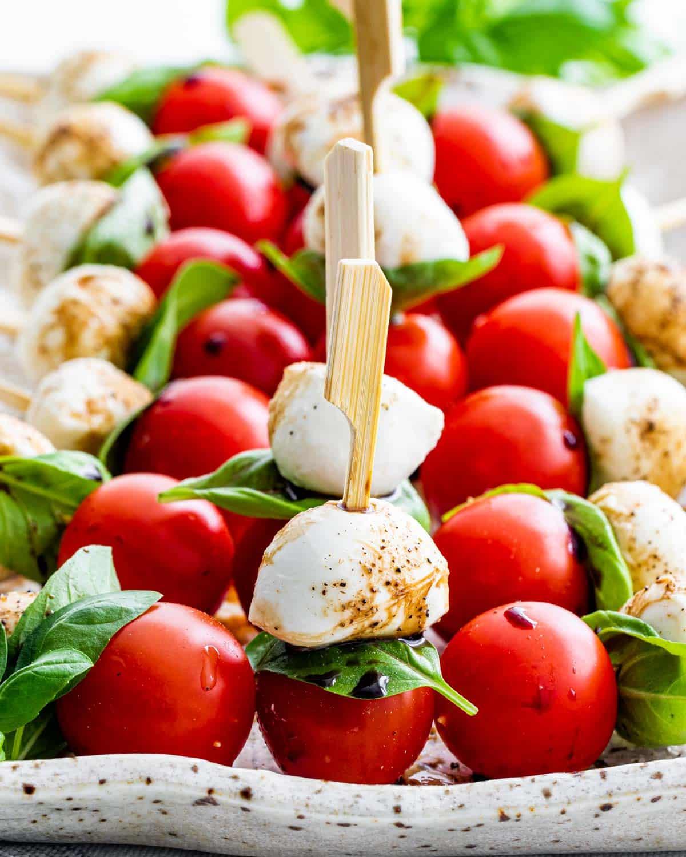 caprese salad bites on a serving platter