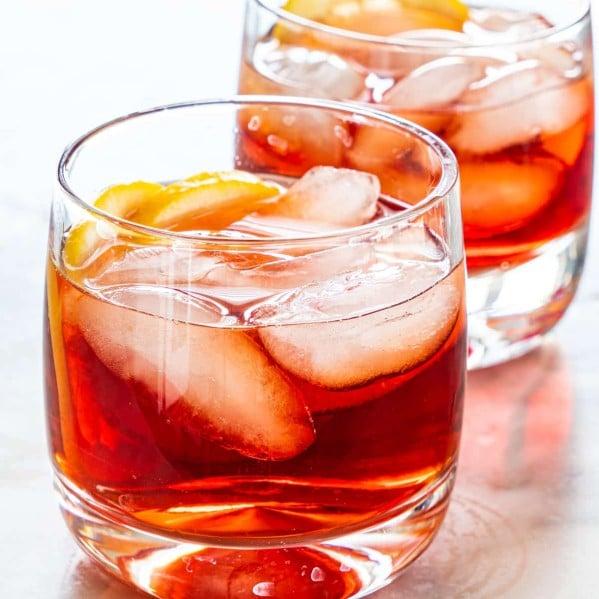 two short glasses of negroni