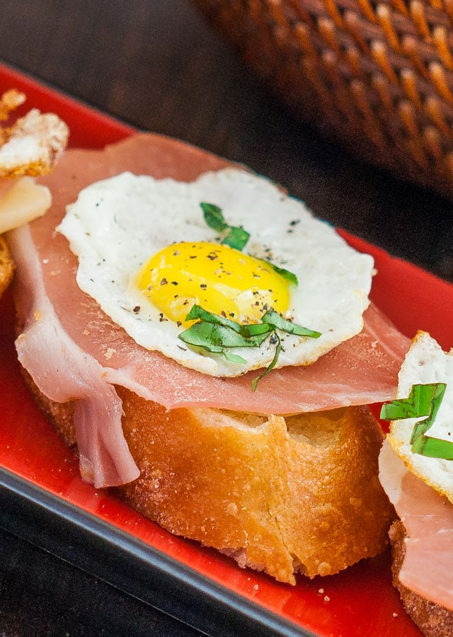Close up shot of Quail Eggs and Prosciutto Crostini