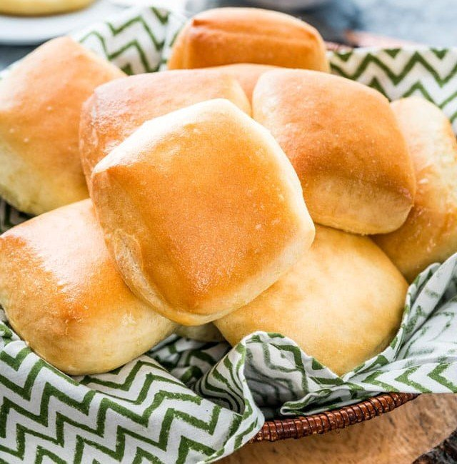 side view shot of a basket full of texas roadhouse rolls