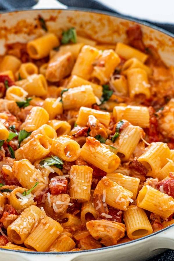 freshly made chicken with blush sauce pasta in a dutch oven braiser.