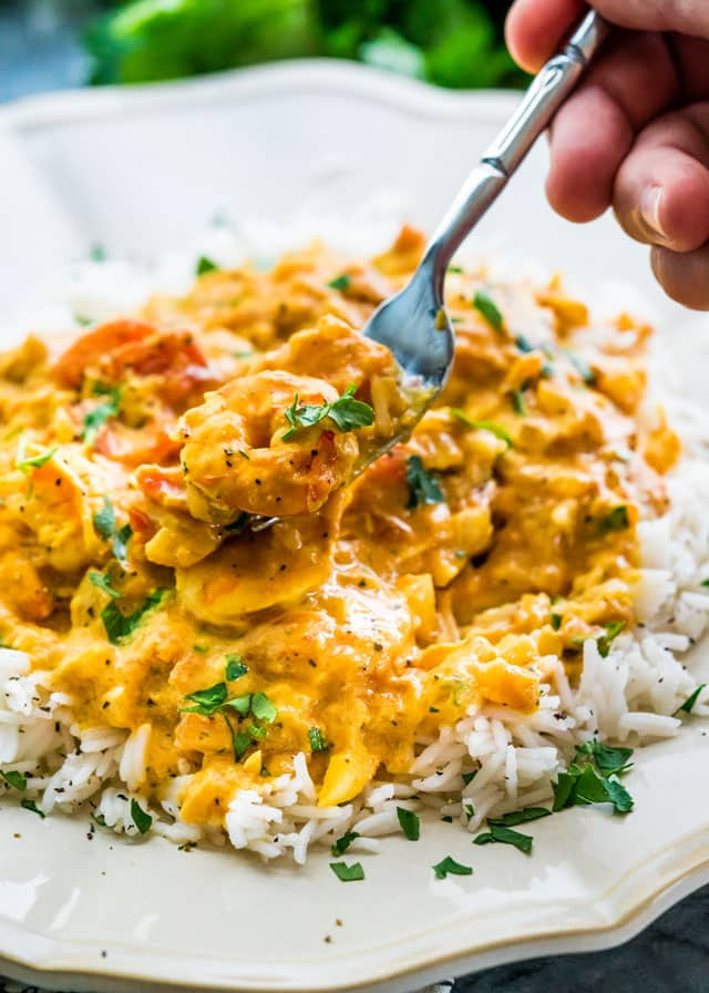 This Coconut Shrimp Curry features delicious shrimp in a coconut curry that's perfect over cooked rice and ready in only 25 minutes! Super easy, one pot and tons of flavors!