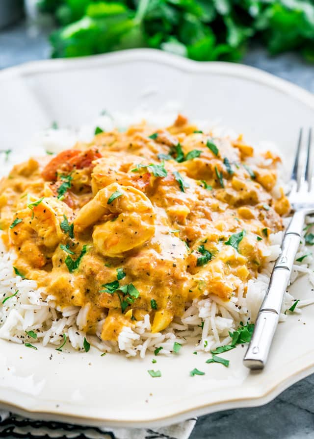 Coconut Shrimp Curry served over rice on a white plate