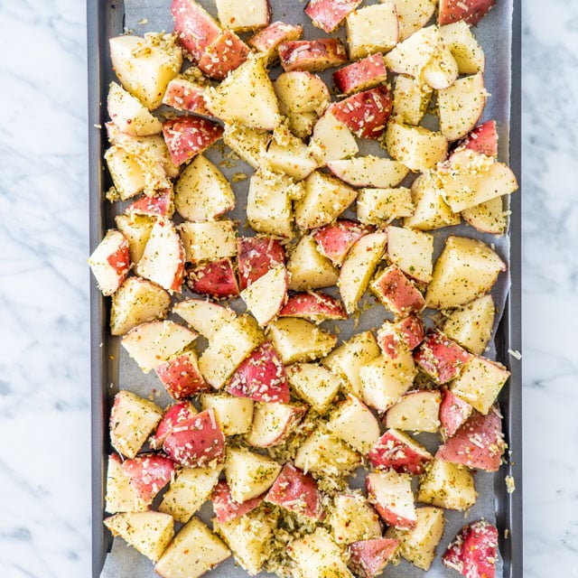 Italian Parmesan Roasted Potatoes on a baking sheet ready to be baked