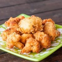 deep fried cauliflower pieces on a plate