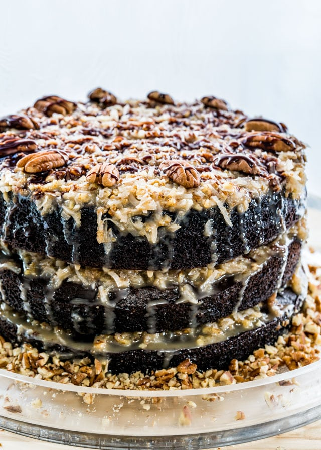 chocolate cake with laters of coconut frosting topped with pecans