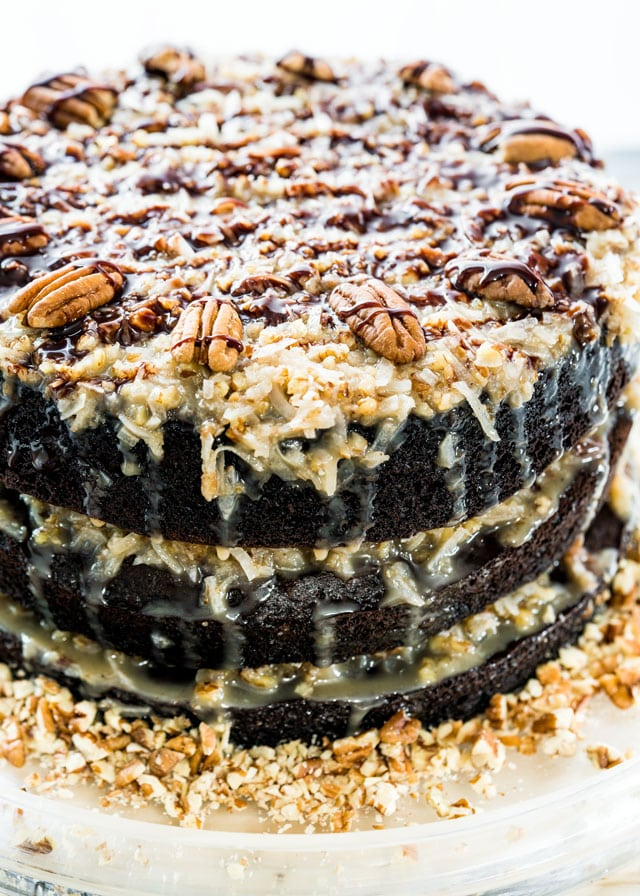 3-layer chocolate cake with coconut frosting topped with pecans