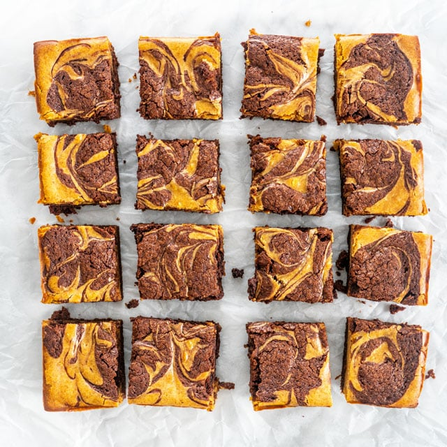 Pumpkin Cheesecake Brownies cut into squares